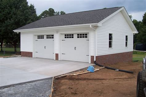 small homes with 2 car garage on foundation 2 car garage with brick foundation