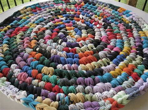 how to crochet a rag rug from t shirts a crochet rag rug of many colors from recycled fabrics flickr photo