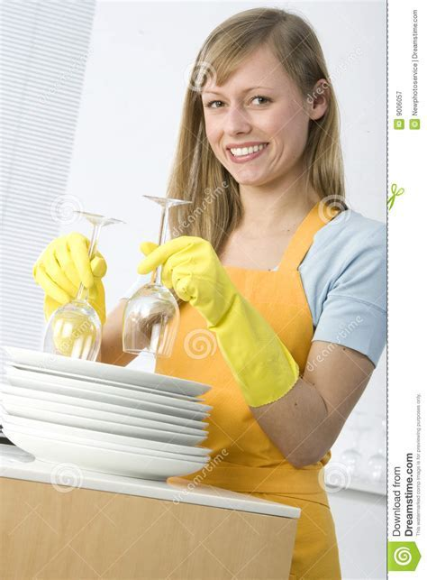 Woman Cleaning Dishes Royalty Free Stock Photography
