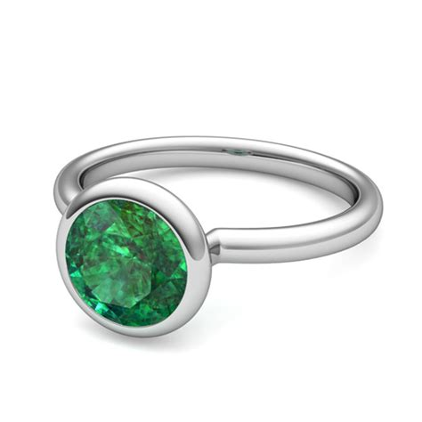 bezel set solitaire emerald engagement ring in 18k gold 7mm