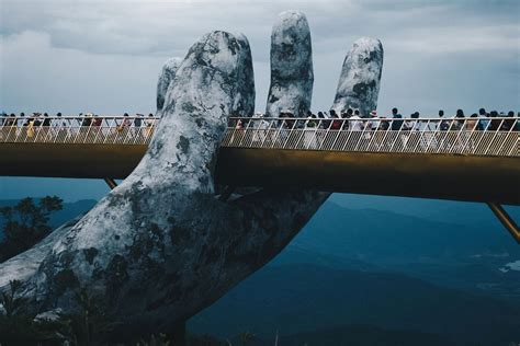 giant hands cradle vietnams  golden bridge  da nang