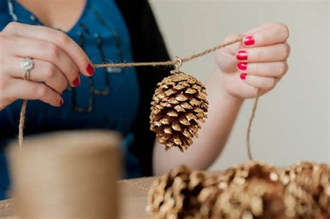 diy decorations with pine cones diy gold leaf pine cone garland the sweetest occasion the sweetest occasion