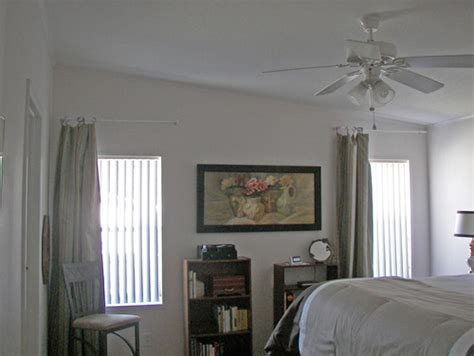 Decorating Ideas For Uneven Walls Help How Do I Decorate A Slanted Wall With Windows