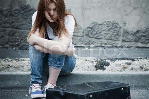 Bonia Segi beautiful sad sitting on asphalt photo in cold