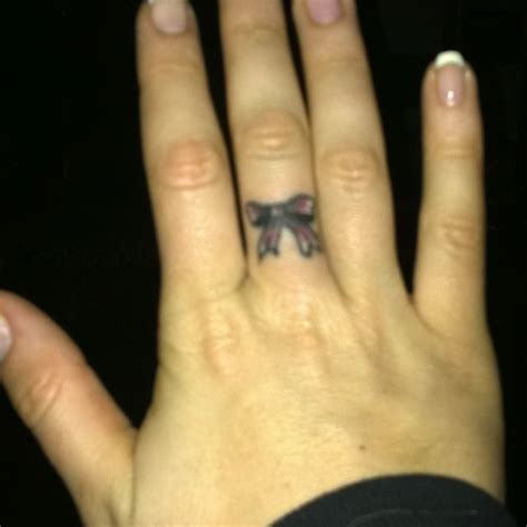 x tattoo on middle finger finger bow tattoo pictures to pin on pinterest page 2