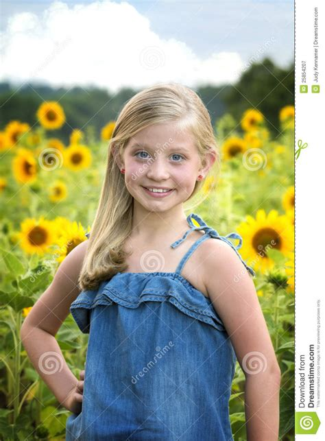 little girls beautiful little girl in front of sunflower field royalty