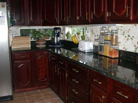 411 Kitchen Cabinets Granite Of West Palm by White Granite Countertops With Cherry Cabinets Beige