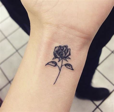 small rose hand tattoo small black on wrist