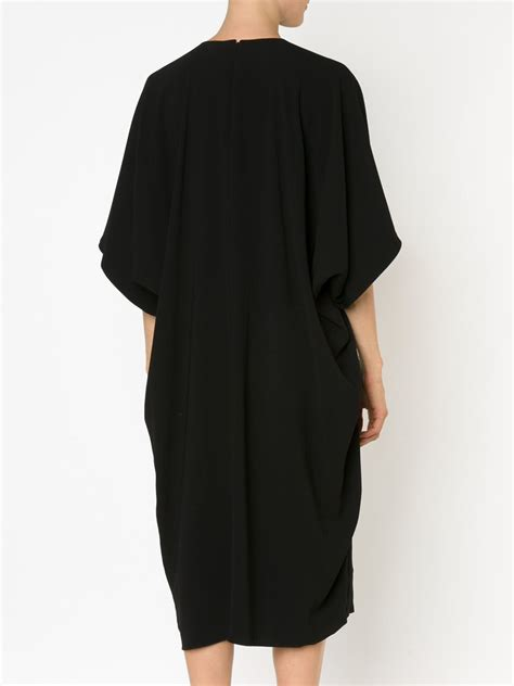 draped gowns co draped back flutter sleeve dress in black lyst