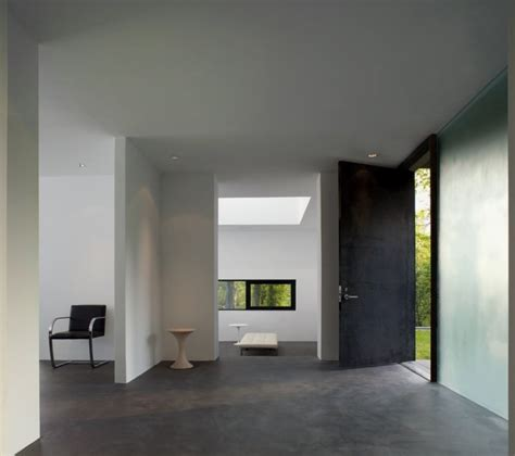 house design with entrance to office from master suite black and white house with modern glass building