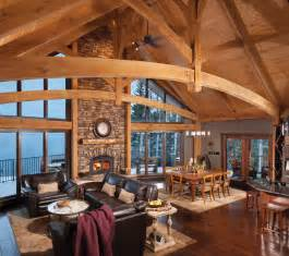 Outdoor Fireplace Tool Sets - mountain timber frame home in canada rustic living room by riverbend timber framing