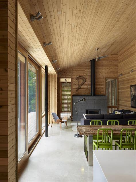 ultra modern cabin blends rustic warmth  modern minimalism