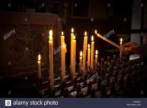 light a candle prayer lighting candle catholic church stock photos lighting