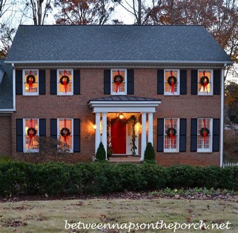 how to hang lights around windows outside hanging wreaths on windows