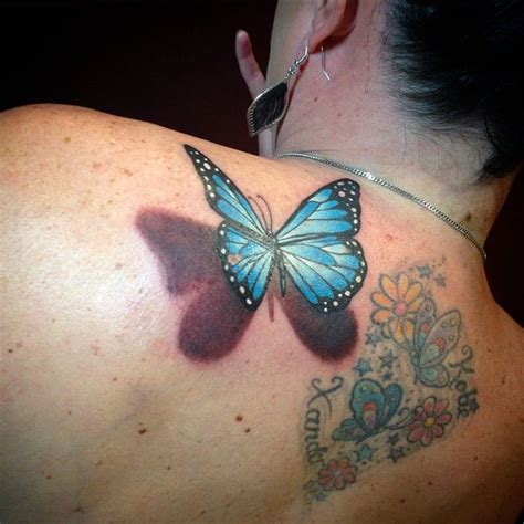 butterfly tattoo going up back butterfly tattoo going up back