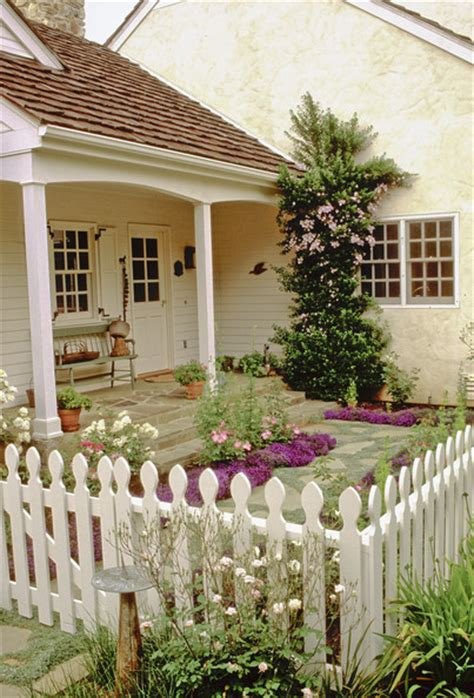 cottage style courtyard garden with white picket fence i