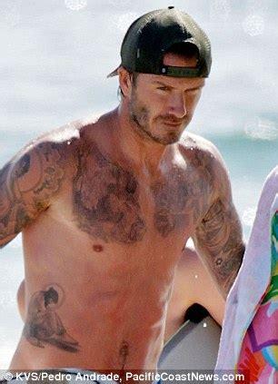 beckham new tattoo 2014 dbriefed david beckham shows off new tattoo at beach