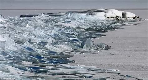 film frozen lake video shows waves of frozen lake superior breaking up on
