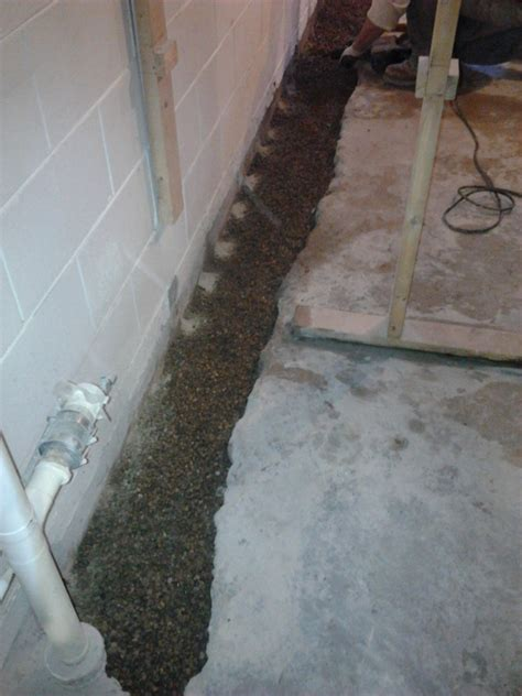 high water table basement solutions water slab foundation repair specialists serving peoria bloomingtonnormal