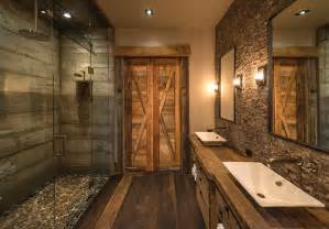 Board formed concrete and a rock rimmed shower floor add rustic