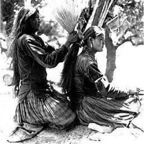navajo woman hair do navajo girl getting her hair done using a navajo hairbrush
