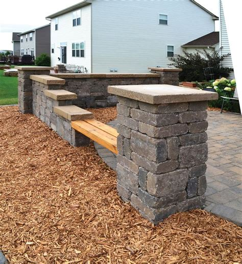 garden retaining wall bench ledgestone columns and walls add a variety of seating