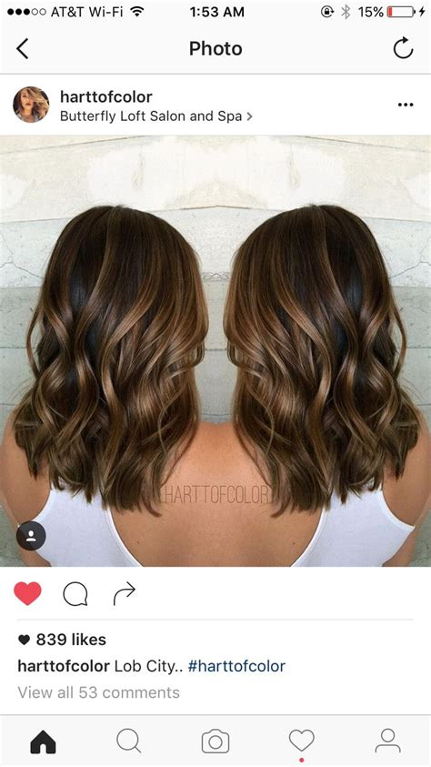 blunt cut with minimal layers cut length big loose waves minimal layers blunt cut