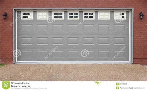 Garage With Doors Brick Wall And Asphalt Driveway Stock Garage Door Wall