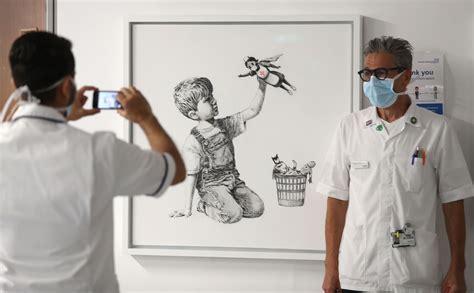 banksys latest artwork celebrates  heroism  hospital