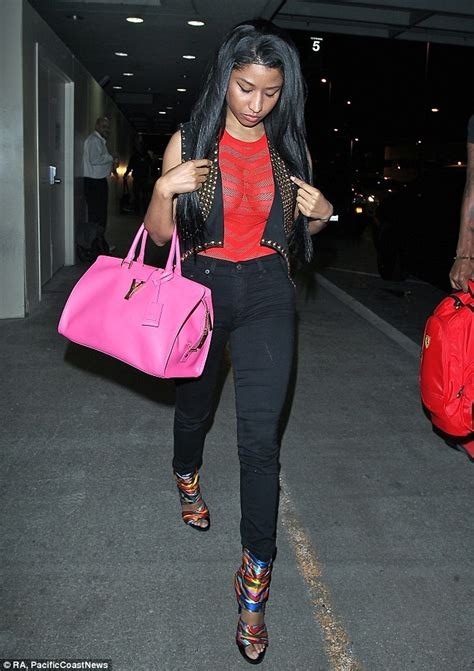 nicki minaj shows off assets in sheer top at lax with