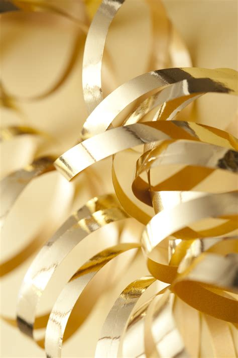Gold Ribbon Themes   curled gold ribbons on yellow background 8982 stockarch