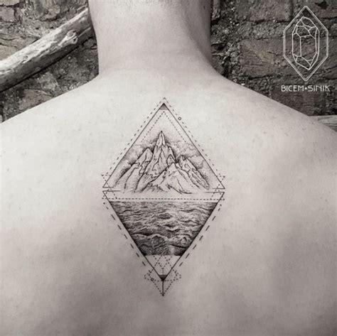 rhombus pattern tattoo big rhombus shaped black ink tattoo of high mountain with