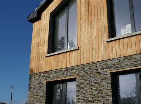 passive house larch cladding dressed stone  white render sustainable design collective