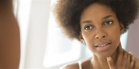 black woman looking in mirror 5 pre bed tips for amazing skin kamdora