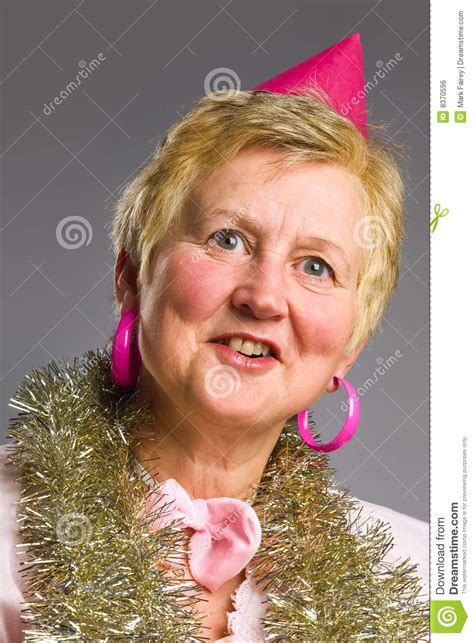 middleage woman fun middle aged woman in pink party hat stock photo image