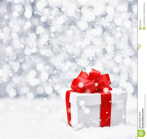 festive christmas gift in snow stock photo image 26291432