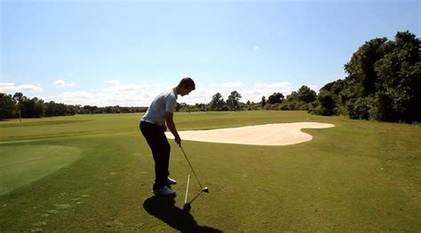 rotary swing golf how to play the ball below your feet on the golf course