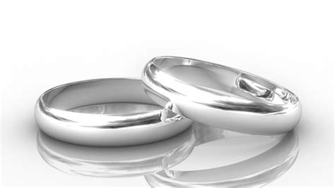 two golden wedding rings with reflection isolated on
