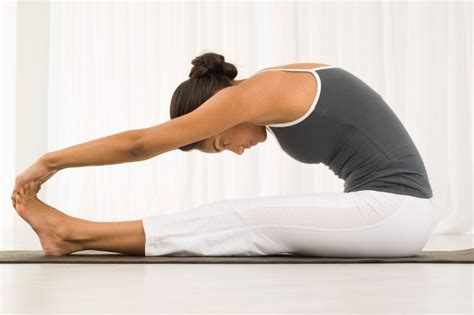 seated forward fold 6 poses to relax through the holidays 42yogis