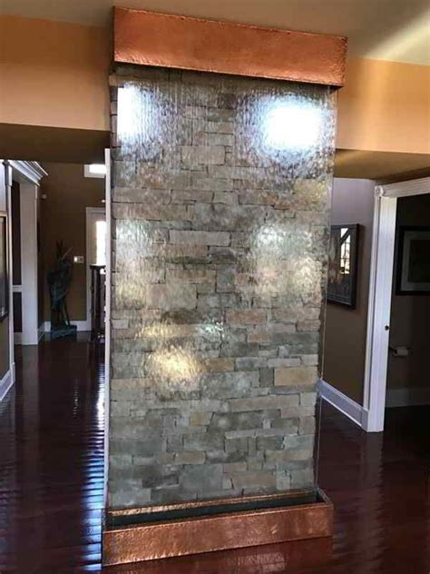 residential stone wall  glass water wall
