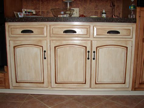 How To Distress White Kitchen Cabinets Creating Distressed Wood Cabinets Only With Paint And Wax Homesfeed