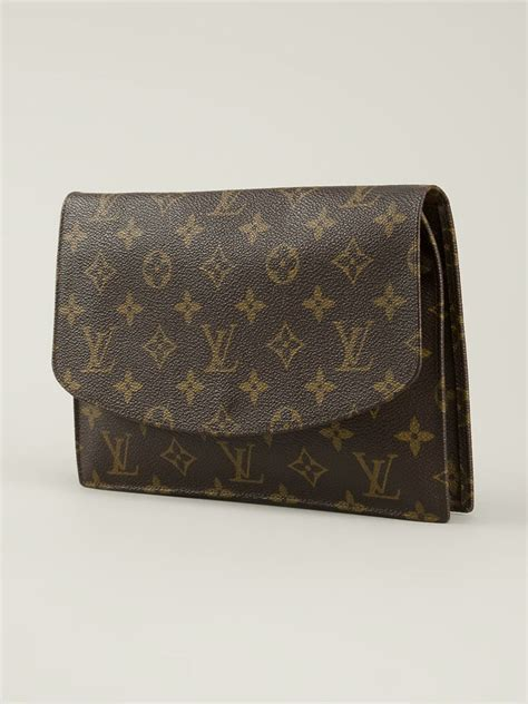louis vuitton monogram clutch  brown lyst