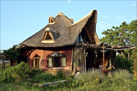 house plans that can be added onto later cob home with thatch roof