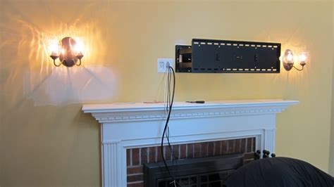 how to install a tv above a fireplace and hide the wires