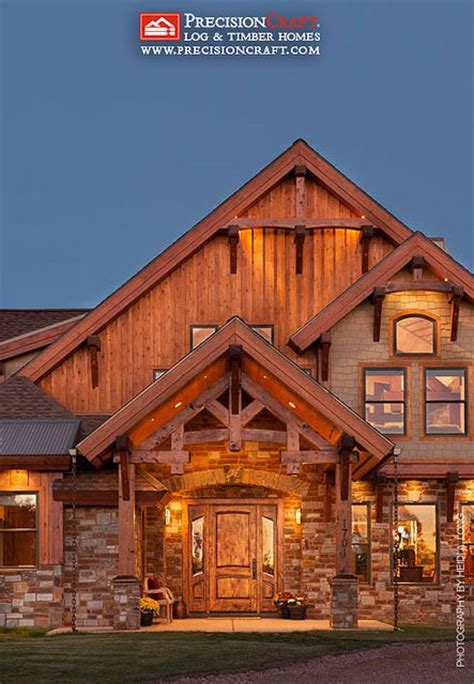 hawksbury timber home plan by precisioncraft log timber front entry to this custom timber frame home