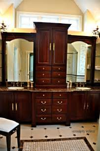 Wood master bathroom cabinets sconces mirrors tile glass shelves