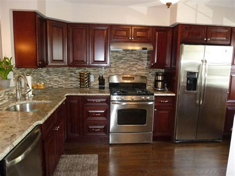mahogany kitchen cabinets modern kitchen stainless steel appliances granite counter tops tile back splash mahogany