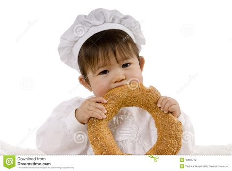 baby eating bread stock photography image
