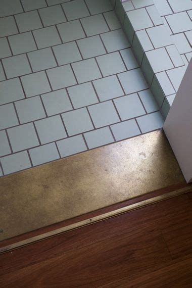 Use of a wide strip of contrasting tile makes a good