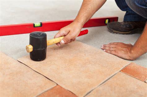 ceramic floor installation installing ceramic flooring fitting a tile stock image image 33647595